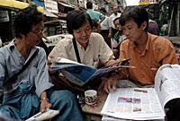 youngmen_reading_200px.jpg