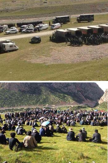 自8月13日起,大批藏人聚集神山开矿地点,反对采矿。大批军车满载军警赶到开矿地点,现场亦有不少警车戒备。(照片来自自由西藏组织)