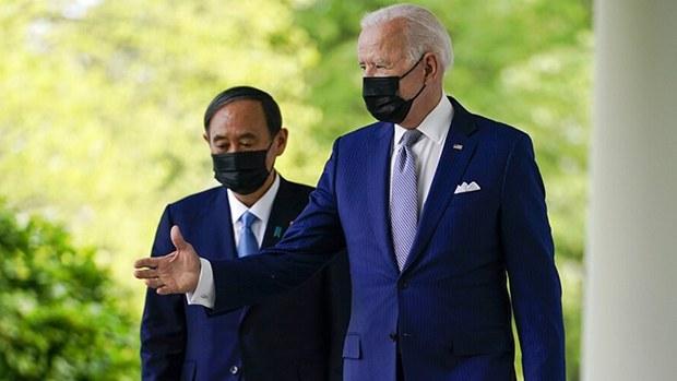 拜登(右)与菅义伟会面后发表联合声明,双方同意合作应对中国挑战。