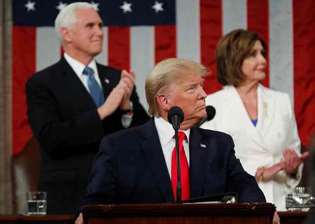 特朗普在白宫举行记者会时表示不会戴口罩。(美联社资料图片)