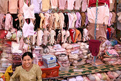 A vendor in Bagan displays her inventory of lingerie made in China, early 2008. RFA/Tyler Chapman