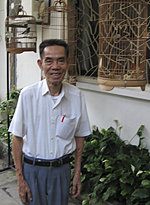 Pham Xuan An with his birdcages in Ho Chi Minh City, 2005<br /> Photo: RFA/Dan Southerland