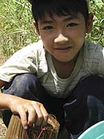 Young boy in Phu Tuc with his fish trap Photo: Dan Southerland