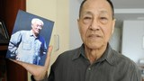 Bao Tong shows a photo of his former boss former Zhao Ziyang at his home in Beijing in a file photo.