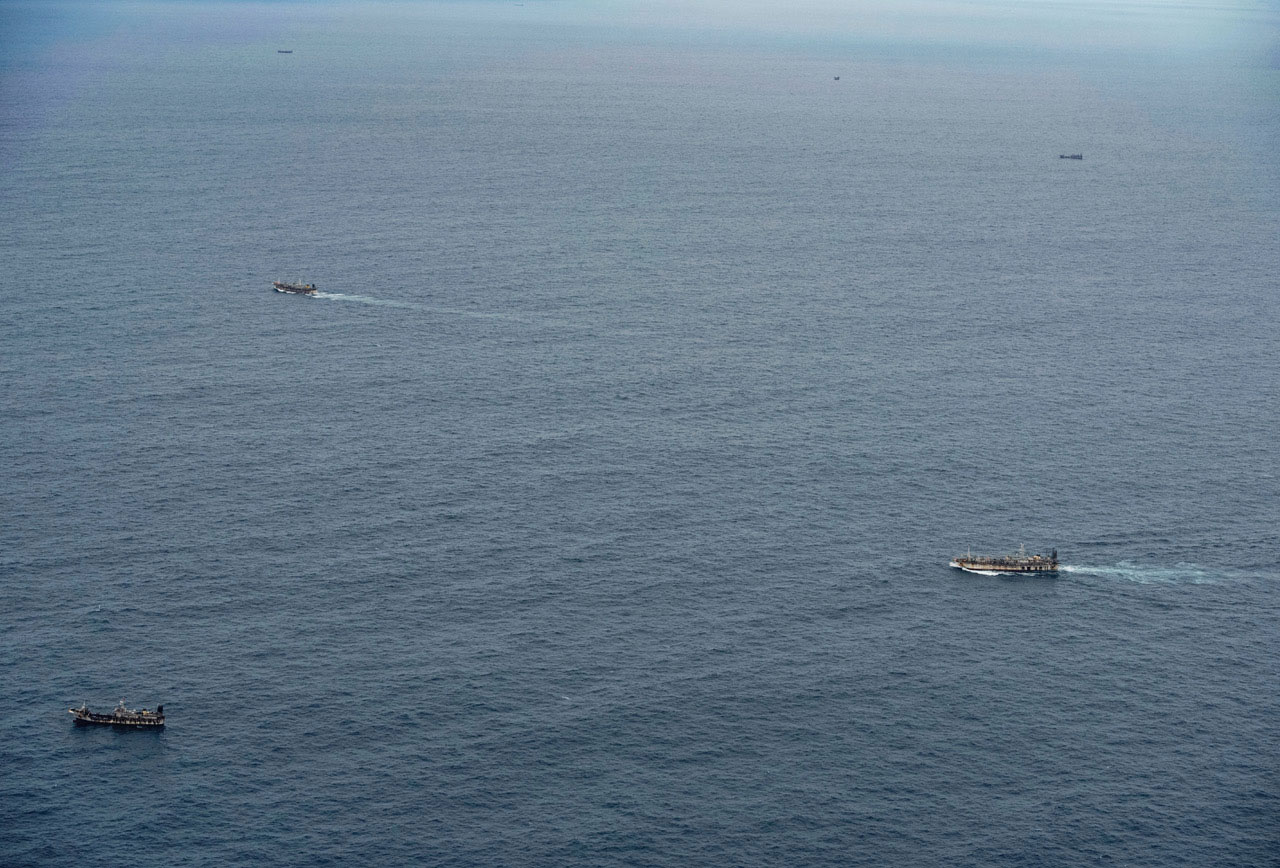 Fishing boats are seen from an aircraft of the Ecuadorian navy after a fishing fleet of mostly Chinese-flagged ships was detected in an international corridor that borders the Galapagos Islands' exclusive economic zone, in the Pacific Ocean, Aug. 7, 2020.