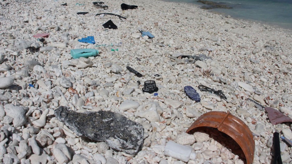 Plastic trash is seen strewn across a beach at Wake Island in the Pacific Ocean, where residents continually comb the beach for waste but more washes up daily, Feb. 2, 2018.