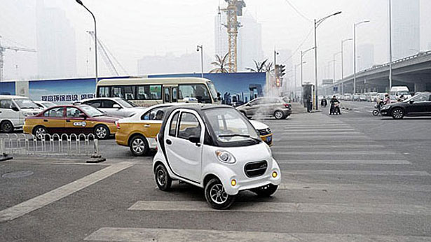 Chinese Produced Electric Car Is Shown On A Beijing Street In File Photo