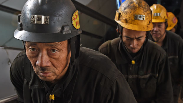 Coal miners leave a mine after their underground shift ends in Datong, northern China's Shanxi province, Nov. 20, 2015.