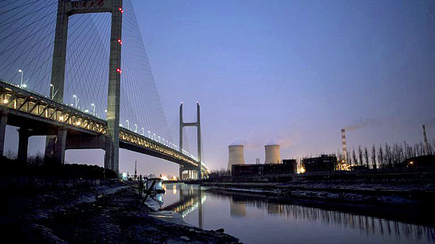 A view of the Wujing Coal-Electricity Power Station from below the Minpu Bridge that spans the Huangpu River in Shanghai, Feb. 21, 2017.