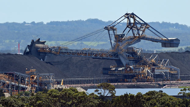 A machine moves coal for export at the Port of Newcastle in the city of Newcastle, New South Wales, Australia, Nov. 18, 2015.