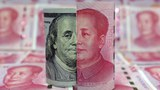 china-yuan-dollar-illustration-jan21-2016.jpg