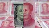 china-yuan-dollar-illustration-jan21-2016.jpg