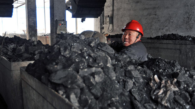 A Chinese laborer works in a coal mining facility in Huaibei, northern China's Anhui province, in a file photo.