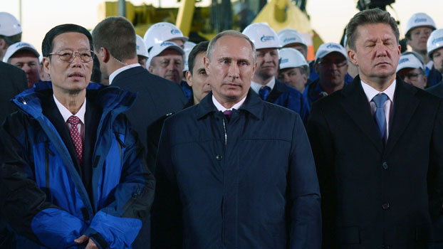Chinese Vice Premier Zhang Gaoli (L), Russian President Vladimir Putin (C), and Gazprom CEO Alexei Miller (R) attend a ceremony marking the welding of the first link of the Power of Siberia main gas pipeline near the village of Us Khatyn outside the remote eastern Siberian city of Yakutsk, Russia, Sept. 1, 2014.