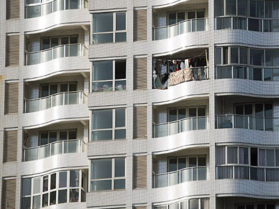 Clothes hang out to dry on a balcony of a residential building in the suburbs of Shanghai, Dec. 3, 2015.