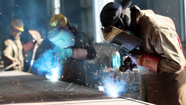A worker cuts steel at a factory in Huaibei in eastern China's Anhui province, May 3, 2018.