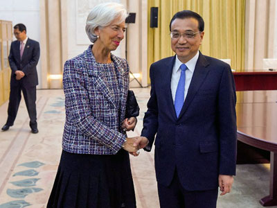 Christine Lagarde (L), managing director of the International Monetary Fund, greets Chinese Premier Li Keqiang (R) at the Belt and Road Forum in the Great Hall of the People in Beijing, May 14, 2017.