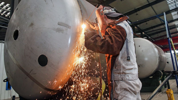 A Chinese worker welds a liquefied natural gas tank at a factory in Nantong, eastern China's Jiangsu province, March 14, 2019.