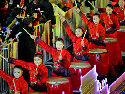 Chinese performers play drum music during a countdown event celebrating the new year at Yongdingmen Gate in China's capital Beijing, Dec. 31, 2017.