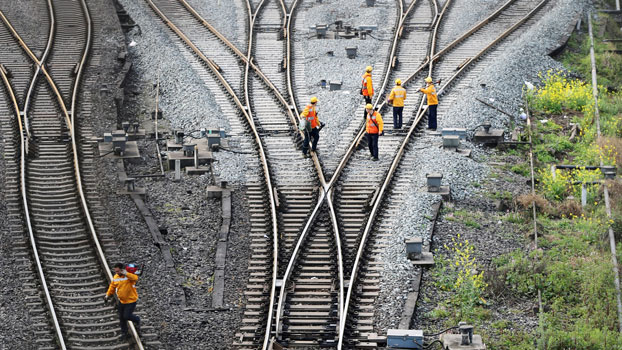 Workers inspect railway tracks that are part of China's Belt and Road freight rail route linking the Chinese city of Chongqing to Duisburg in western Germany, at the Dazhou railway station in southwestern China's Sichuan province, March 14, 2019.