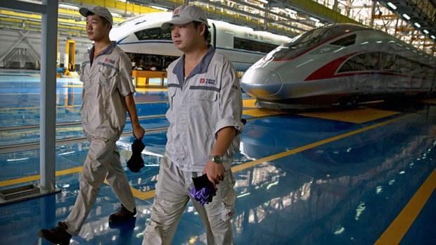 china-workers-high-speed-trains-beijing-aug30-2018.jpg