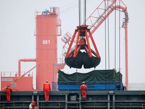 Coal is loaded into a bulk carrier at Qingdao Port, Shandong province, China, April 21, 2019.
