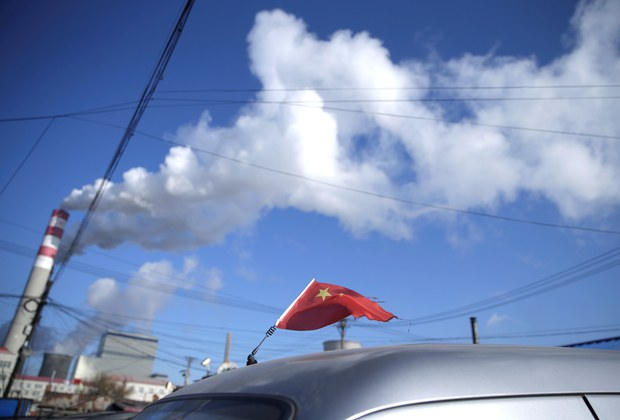 A Chinese flag is seen on the top of a car near a coal-fired power plant in Harbin, Heilongjiang province, China November 27, 2019. Picture taken November 27, 2019.