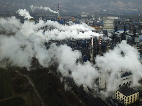 In this Nov. 28, 2019, file photo, smoke and steam rise from a coal processing plant in Hejin in central China's Shanxi Province.