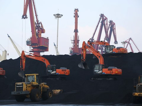 Workers operate loaders unloading imported coal at a port in Lianyungang, Jiangsu province, China December 5, 2019.
