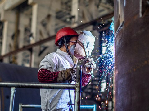A worker produces machinery at a factory in Nantong, in China's eastern Jiangsu province, May 26, 2021.