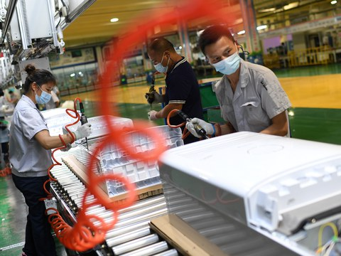 Employees wearing masks work on the air conditioner production line at a Gree factory, following the coronavirus disease (COVID-19) outbreak in Wuhan, Hubei province, August 9, 2021. Picture taken August 9, 2021.