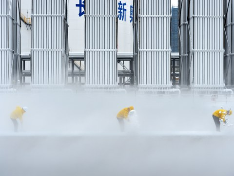 Workers remove snow at a liquefied natural gas (LNG) facility of ENN Group in Changsha, Hunan province, China December 31, 2018.