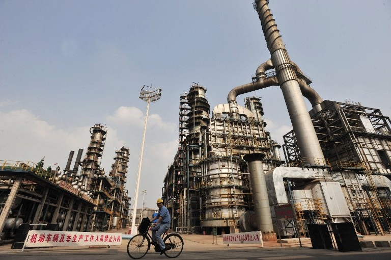 A worker rides a bicycle at a Sinopec oil refinery in Wuhan, Hubei province, in a file photo.