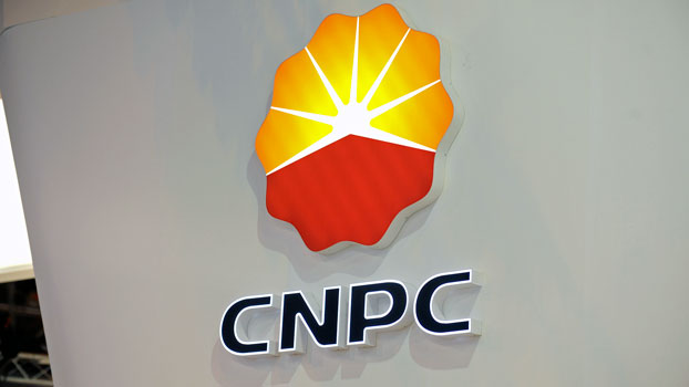The logo of China's largest oil producer China National Petroleum Corporation hangs on a wall during the World Gas Conference exhibition in Paris, June 2, 2015.