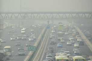 Traffic commutes through heavy smog in Beijing, Nov. 21, 2012.