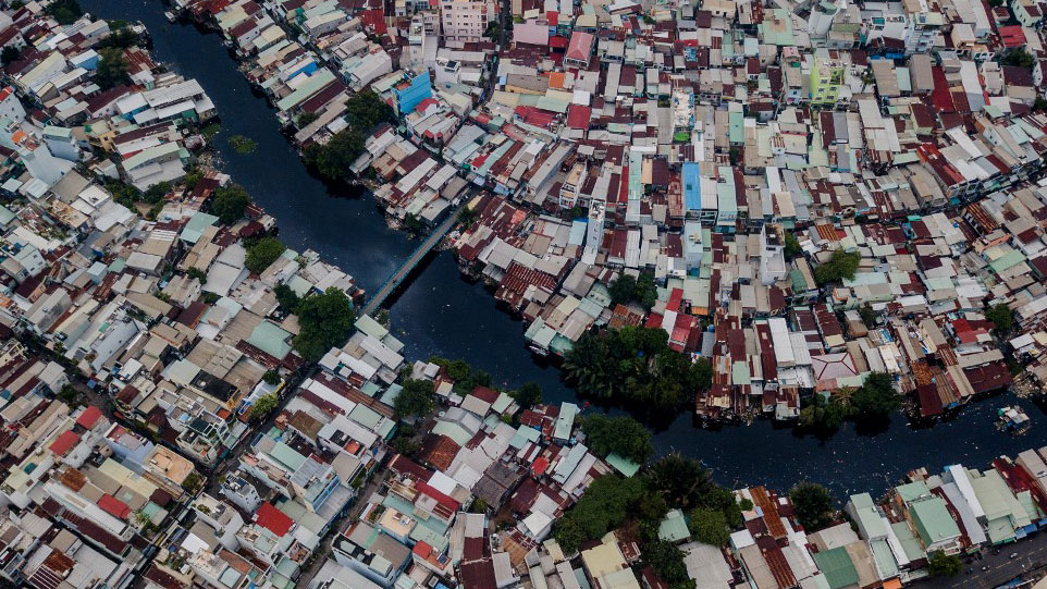 Houses along the Xuyen Tam canal in Ho Chi Minh City, Vietnam, in aerial photo taken on Oct. 19, 2018.