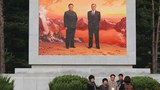North Korea's economy was set back by the economic autarky of late leaders Kim Il Sung (R) and Kim Jong Il (L), seen in a portrait at the country's Mount Kumgang resort on the North's southeastern coast , October 21, 2015.