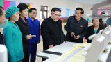 North Korean leader Kim Jong-Un (C) visiting a process of quilt production at the Pyongyang Kim Jong Suk Silk Mill in Pyongyang, in undated photo released by North Korea's official Korean Central News Agency (KCNA), Jan. 9, 2017.