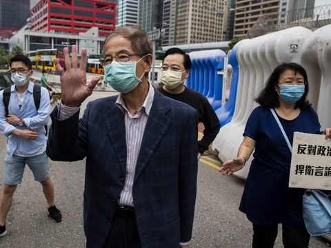 Former lawmaker and pro-democracy activist Martin Lee (C) gestures as he leaves the Central District police station in Hong Kong on April 18, 2020, after being arrested and accused of organizing and taking part in an unlawful assembly in August last year.
