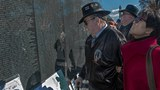 War author and correspondent Joseph Galloway (L) and his wife Grace Galloway (R) stand at the Vietnam Memorial wall in in Washington looking at Panel 3 East, and all 305 names of those who fell in the Ia Drang campaign engraved in the wall, in file photo.