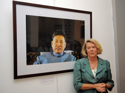 Former Washington Post correspondent Elizabeth Becker stands next to a photo of former Khmer Rouge leader Pol Pot during her photo exhibition at Bophana center in Phnom Penh, in 2012 file photo.