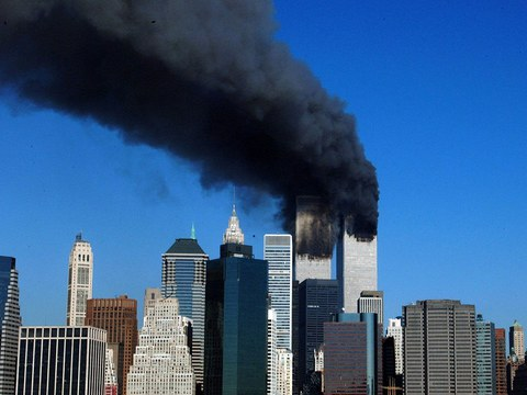 The twin towers of the World Trade Center billow smoke after hijacked airliners crashed into them.