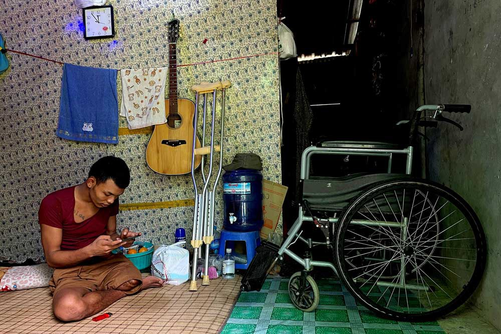 The loss of his leg is a small sacrifice, Ko Phyo says, compared to that of the hundreds killed, including one of his fellow guards, a 15-year-old girl. (REUTERS)