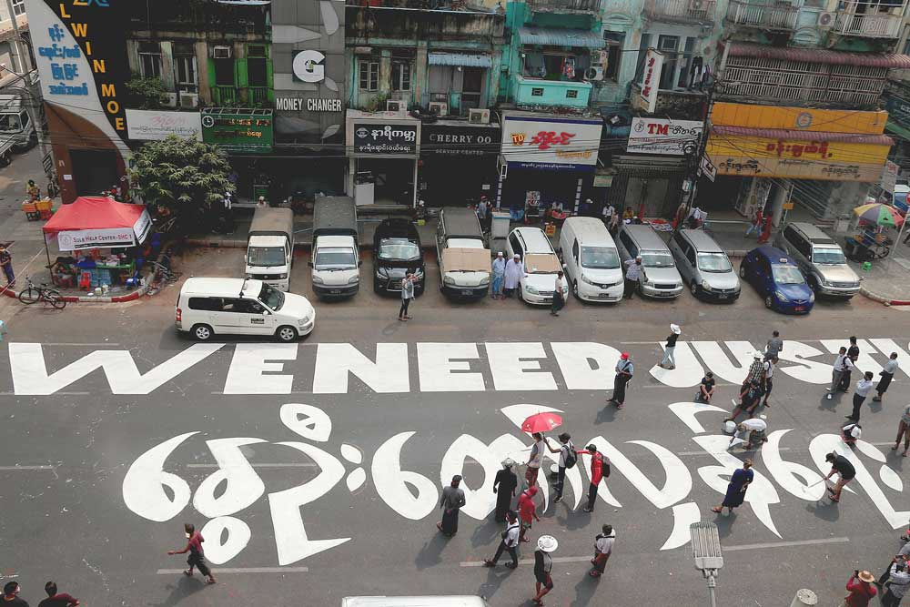 """The message """"We need justice"""" is visible from the upper floors of surrounding buildings. (RFA)"""