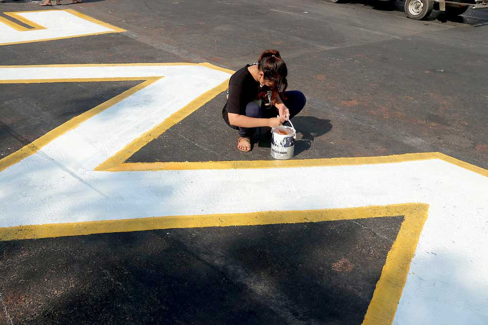 A street message receives some detail work. (RFA)