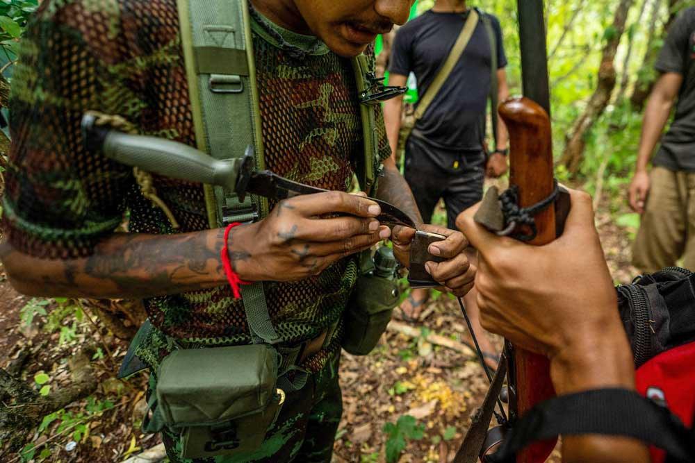 A KPDF member examines a magazine of ammunition. (AFP)