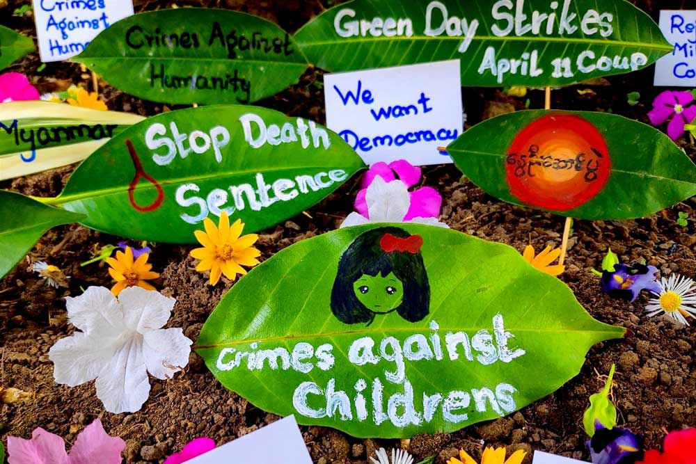 "Slogans and photos decorate leaves as part of a ""Green Day Strike"" held this past week. (AFP/Anonymous source)"