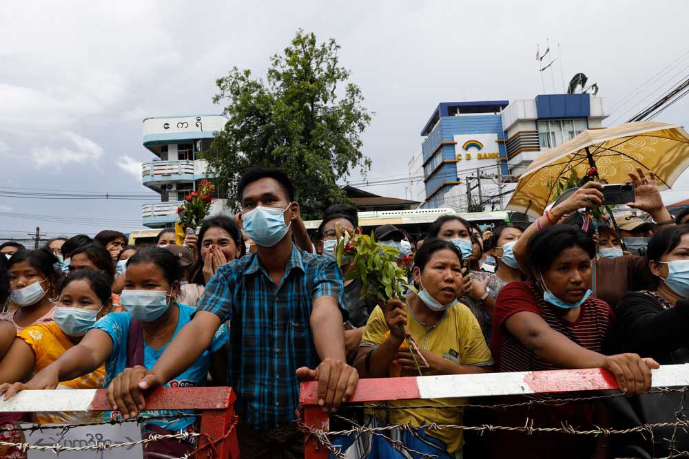 Friends and family members wait for their loved ones outside Insein Prison in Yangon. (Citizen journalist)