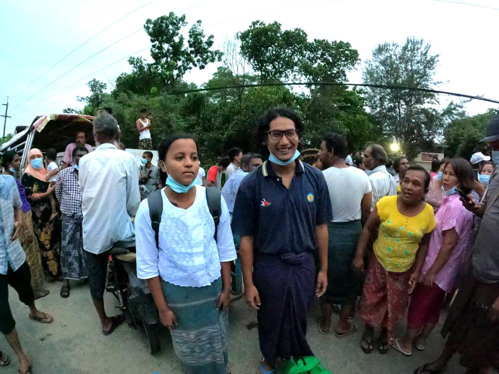 Journalists Kay Son Nway, left, and Ye Myo Khant stand together after their release from Insein Prison in Yangon on Wednesday. (Myo Min Soe/RFA)