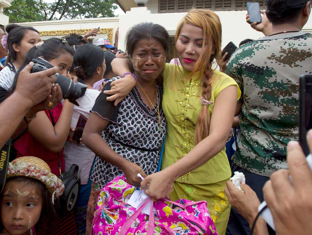 A female prisoner, right, is welcomed by her mother after being released from Insein Prison. (AP)